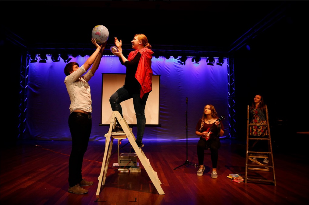 Flickbook Theatre rehearsing 'Cartography' using ladders, a globe, and a ukelele.